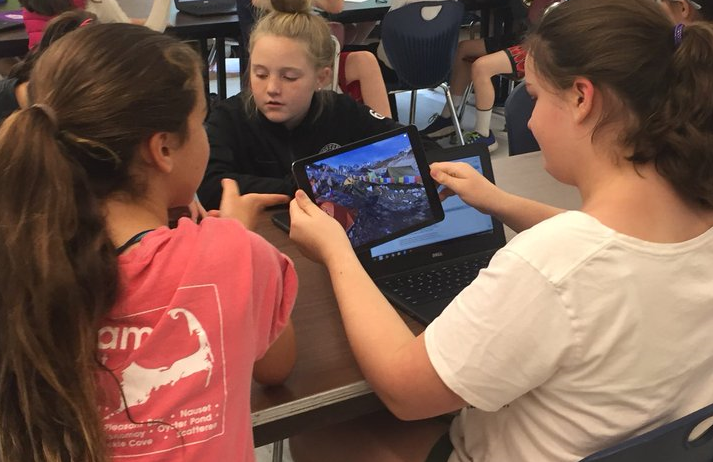 Students using an ipad and a chromebook